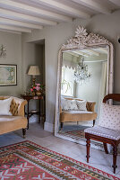 Patterned rug from GH Shaw with large French antique mirror, sourced from Hattie Hatfield Decorative Antiques & Interiors