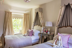 Twin beds, with canopies