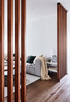 View through wooden partition wall into living room