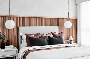 Elegant bedroom with natural-wood wainscoting