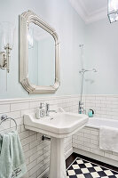 Tiled dado and palest blue walls in classic bathroom