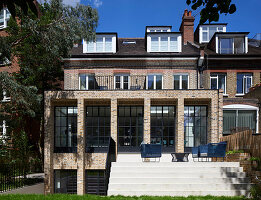 Classic brick house with lattice windows and terrace