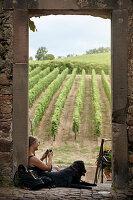 Woman resting, vineyard on background