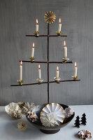 DIY, stylised Christmas-tree arranged in metal bowl against grey wall