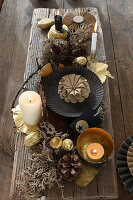 DIY Advent arrangement with Christmas decorations and dried plants on long wooden board