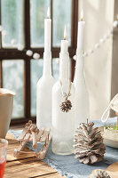 Frosted bottles used as candlesticks