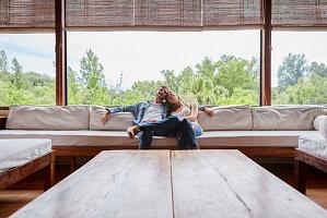 Adult couple sitting on sofa