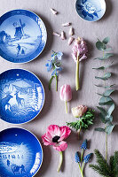 Blue-and-white decorative plates, spring flowers and eucalyptus sprigs