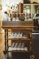 Drinks trolley with bottles and glasses