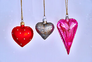 Christmas decorations in red, gold-and-silver and pink