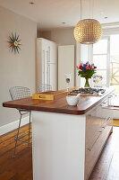 White kitchen counter with wooden worktop