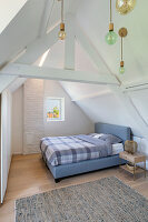 Double bed in attic bedroom