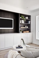 TV in fitted wall unit