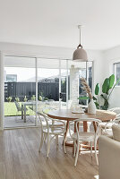 Round dining table and chairs next to terrace doors
