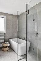 Free-standing bathtub and glass walk-in shower in bathroom