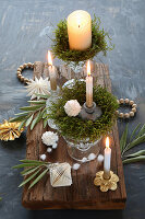 DIY Advent arrangement with real moss in a crystal glass