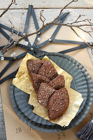 Homemade, gluten-free almond and chocolate biscuits on golden foil