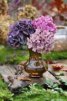 Trio of hydrangeas in glass vase