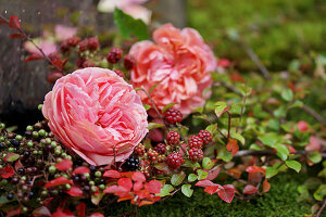 Roses, berries and branches of leaves