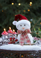 Snowman with santa hat and bow