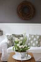 Bowl of white tulips on the coffee table in the living room