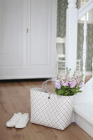 Shopping bag with a bouquet of stocks and feverfew