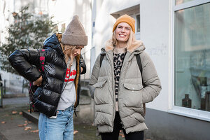 Two women in autumn clothes taking a walk