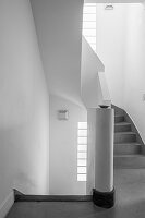 White stairwell with grey spiral staircase