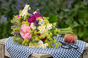 Rural summer bouquet with roses, lady's mantle, feverfew, lavender and carnations