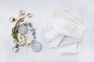 Christmas decorations in silver and white napkins