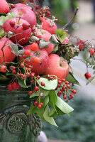Autumn arrangement with apples and rose hips