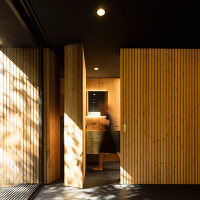 Timber clad bathroom interior in a Pavilion Hous