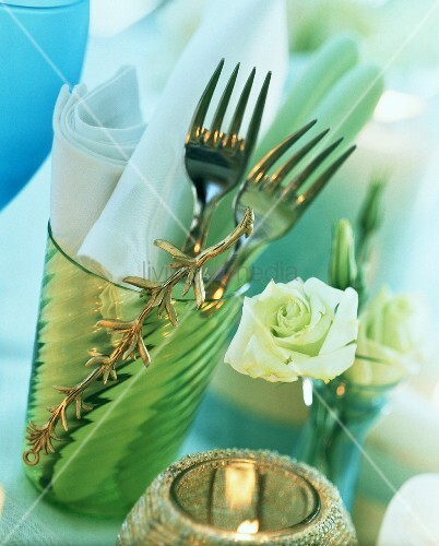 Table setting for two: forks and napkins in glass