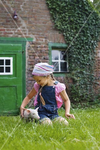 A girl and a piglet