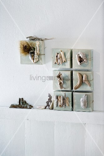 Driftwood and flotsam and jetsam arranged artistically on canvases leaning against a wall