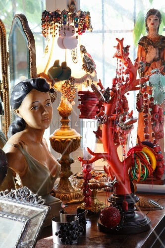 Collection of souvenirs on sideboard - jewellery tree, bust, bedside lamp