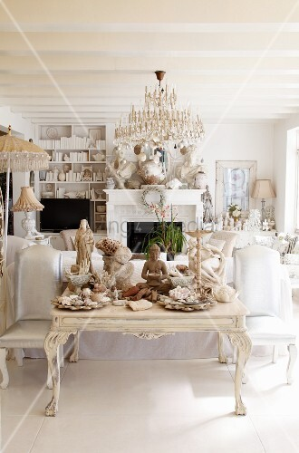Eclectic collection of sculptures in white living room
