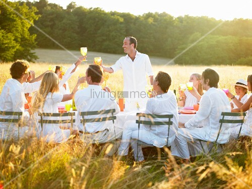 Group of people having dinner, sunset