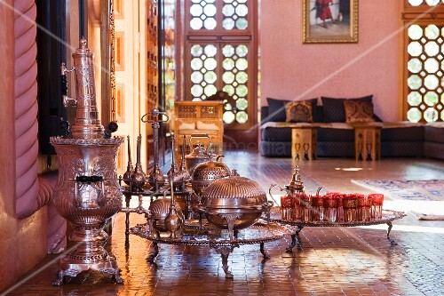 Antique silver tea set and floor trays in a salon marocain