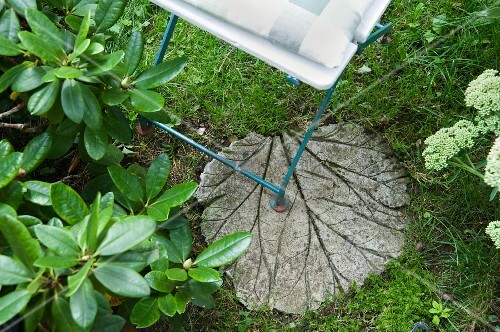 Garden stepping stone shaped like a rhubarb leaf