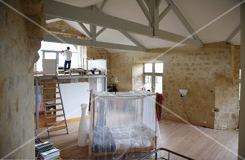 Refuge in Chateau Maignaut with wooden-beamed ceiling and ancient sandstone walls