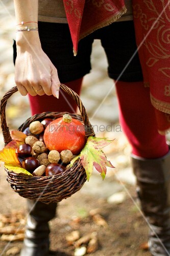 Young woman with autumnal wicker basket