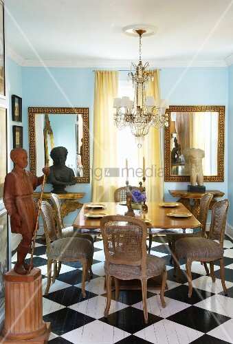 Curved dining chairs with mesh backrest on checkerboard floor in a traditional setting