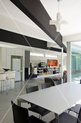 Modern, open room with eating area in the foreground