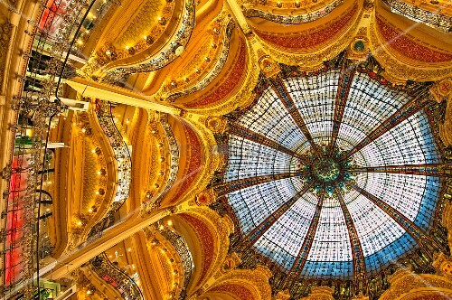 The stained glass dome of Galeries Lafayette, a large opulent art nouveau and historic department store in the centre of Paris