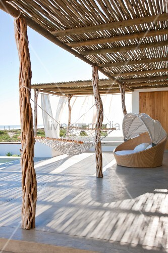 Sun terrace with rustic sun shade, mesh hammock and wide ocean vista