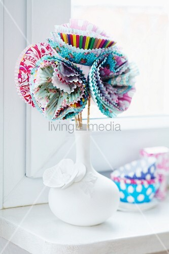 Vase of flowers made from paper cake cases