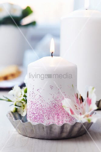Tart tin used as candle holder decorated with waxflowers & lilies