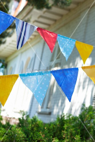 Colorful pennant in front of a house