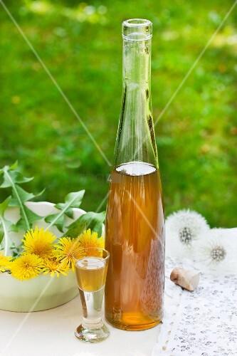 Bottle and glass of dandelion flower liqueur